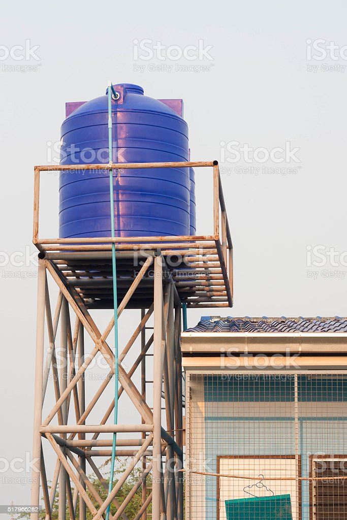 Blue water tank on the tower. stock photo