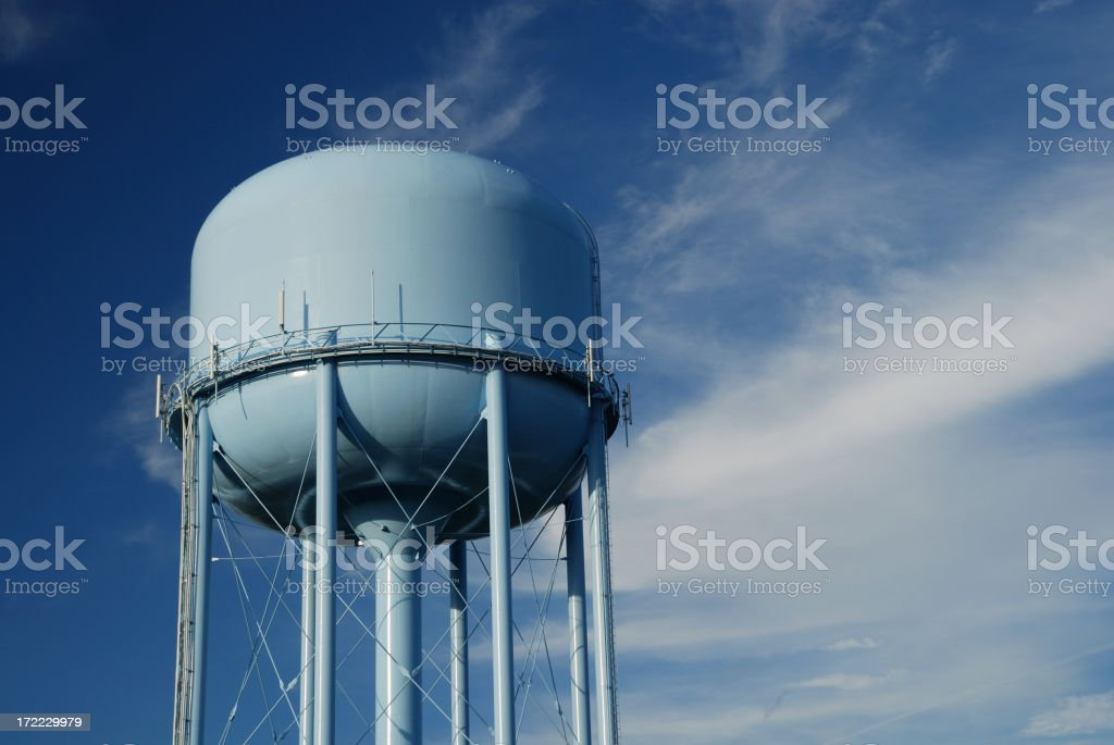 Blue water tower and cloudy sky stock photo