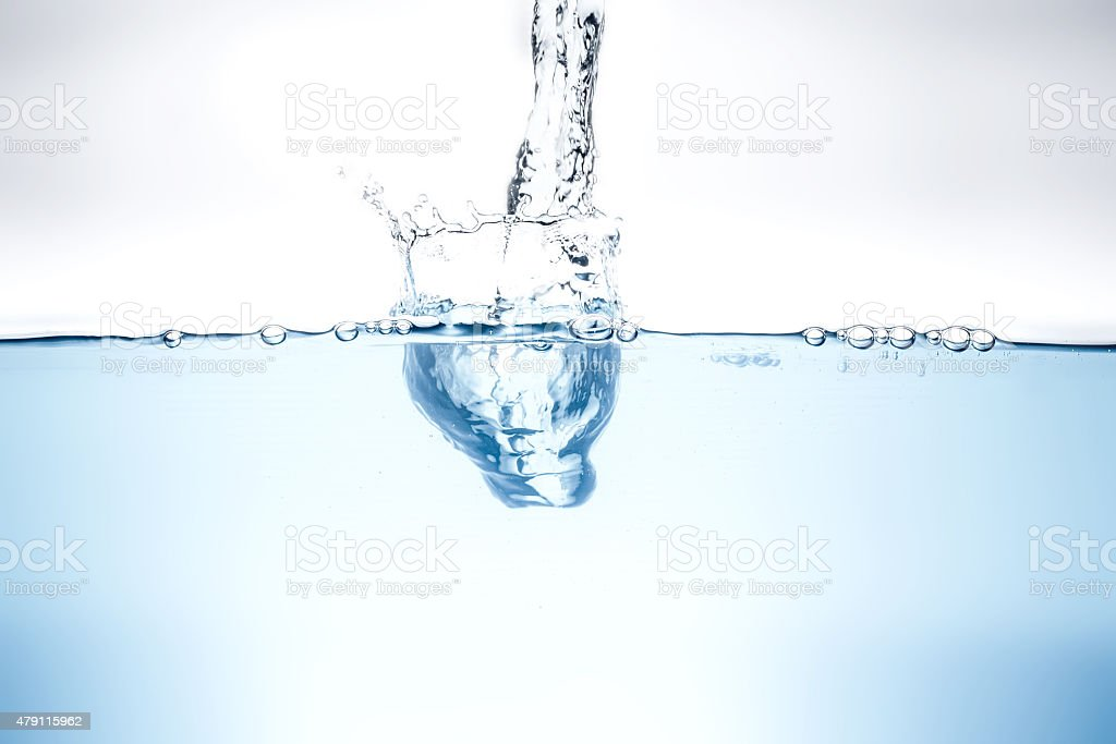 Blue water wave and bubbles to clean drinking water. stock photo