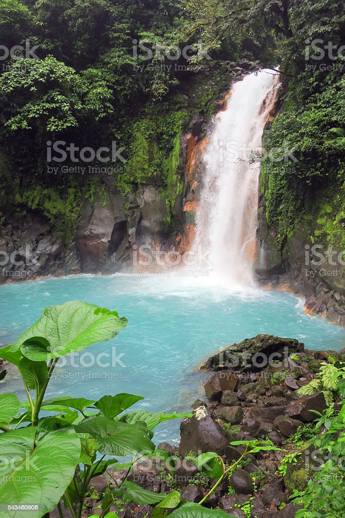 Blue waterfall in jungle Costa Rica stock photo