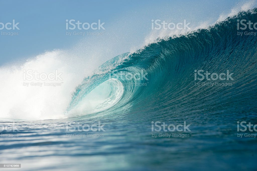 blue wave breaking stock photo