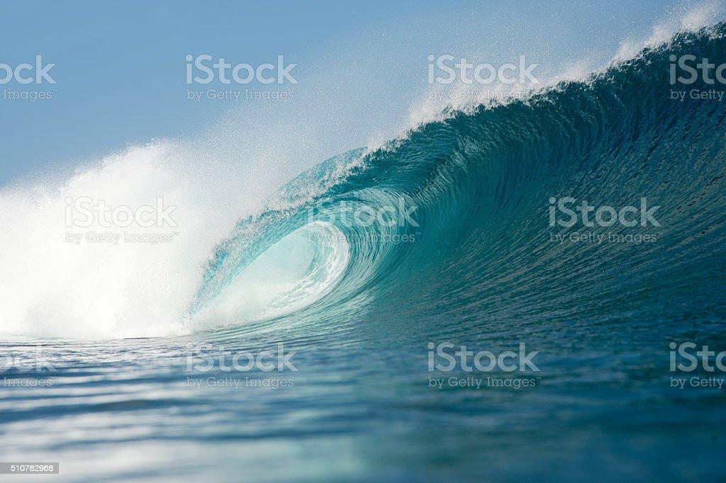 blue wave breaking stock photo