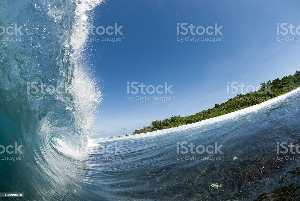 blue wave breking over shallow coral reef royalty-free stock photo