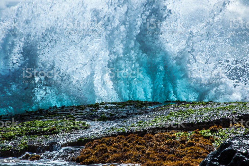 Blue Wave Crashing on the Rocks stock photo