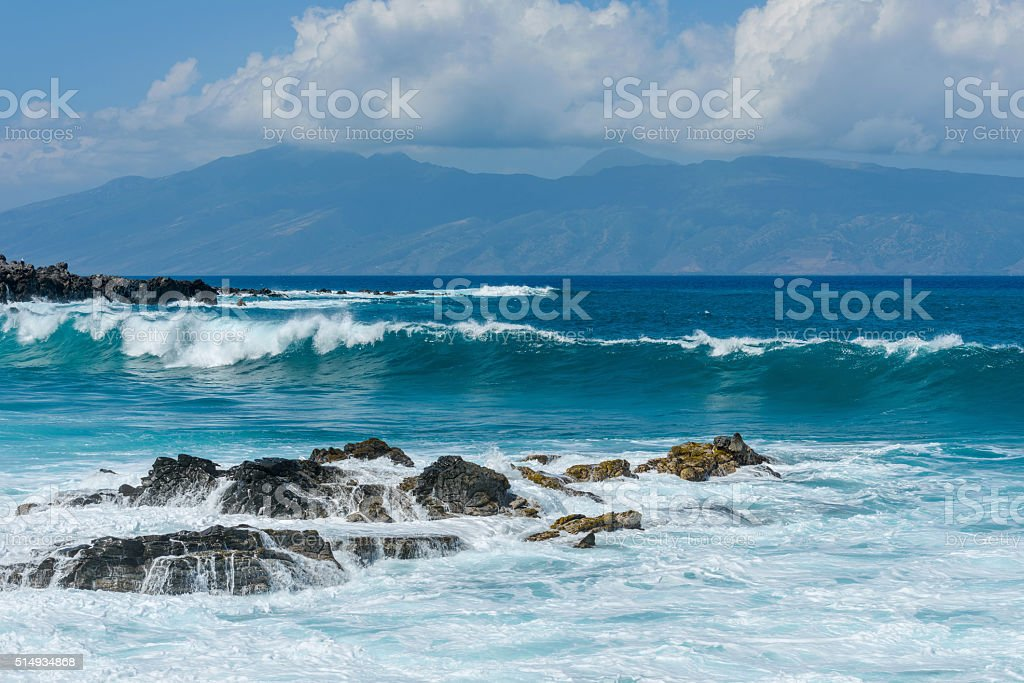 Blue Waves and Rocky Shore stock photo