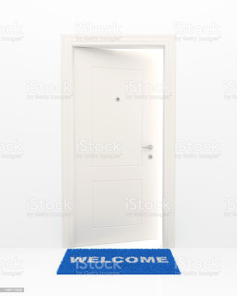 Blue welcome mat and open door stock photo