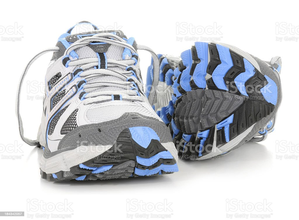 Blue, white and gray sports shoes on white stock photo