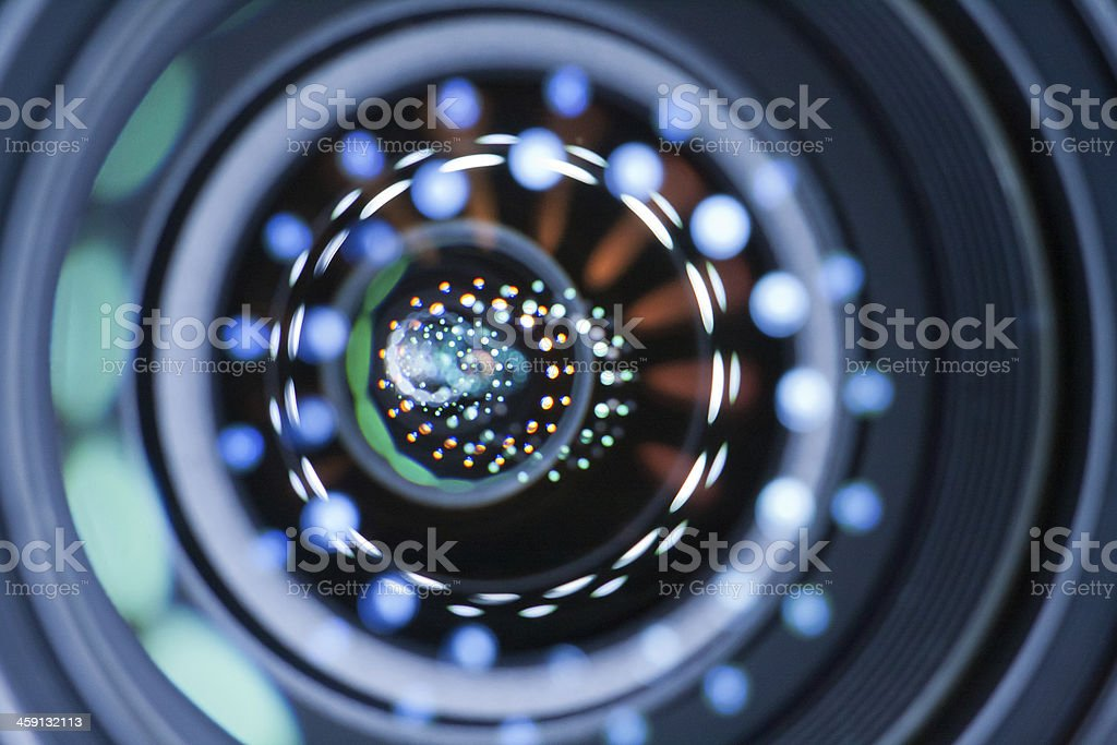 Blue, white, and green Light reflection in lenses of a lens stock photo