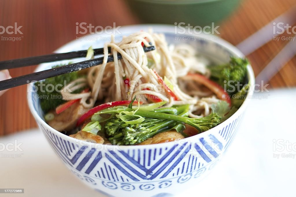 Blue & White Bowl of Asian Noodle Salad stock photo