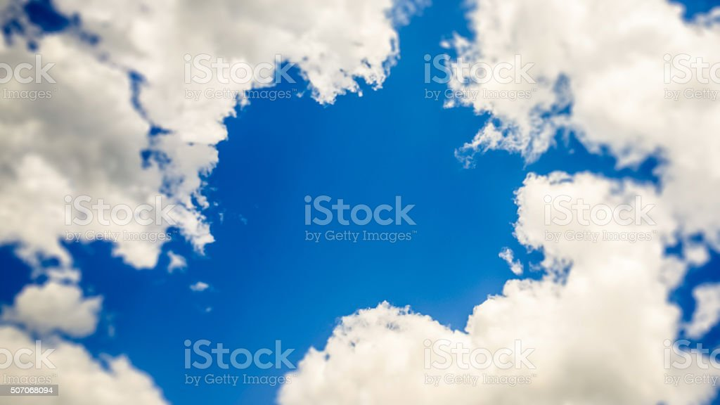 blue window in the cloudy sky tilt shift selective focus stock photo