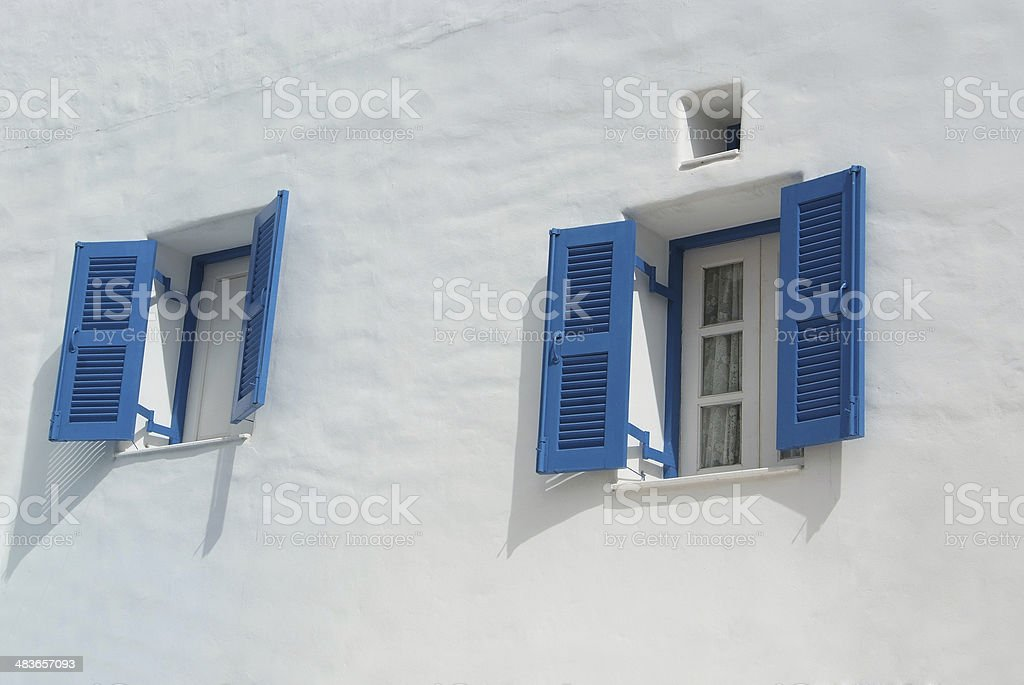blue window on the white wall stock photo