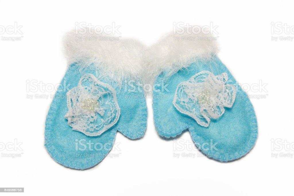 Blue  winter gloves.Handmade Christmas decoration isolated on white. stock photo
