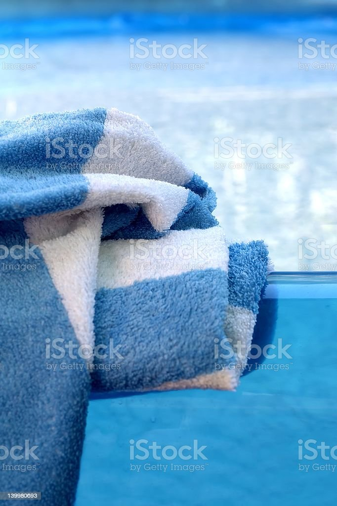 Blue with white towel on the pool royalty-free stock photo