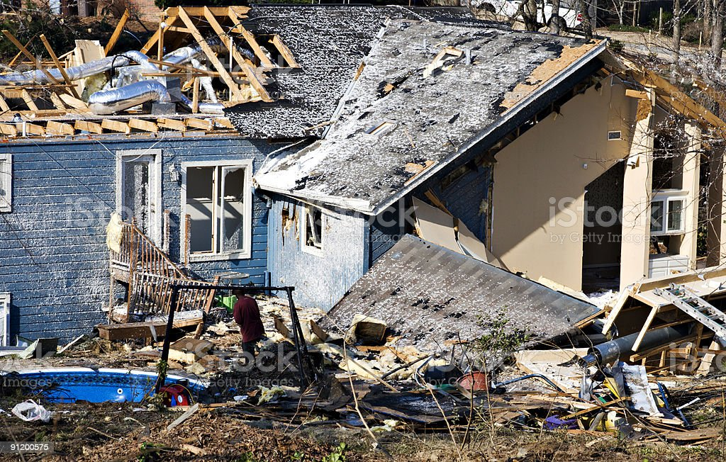 Blue wood framed house destroyed by a tornado stock photo