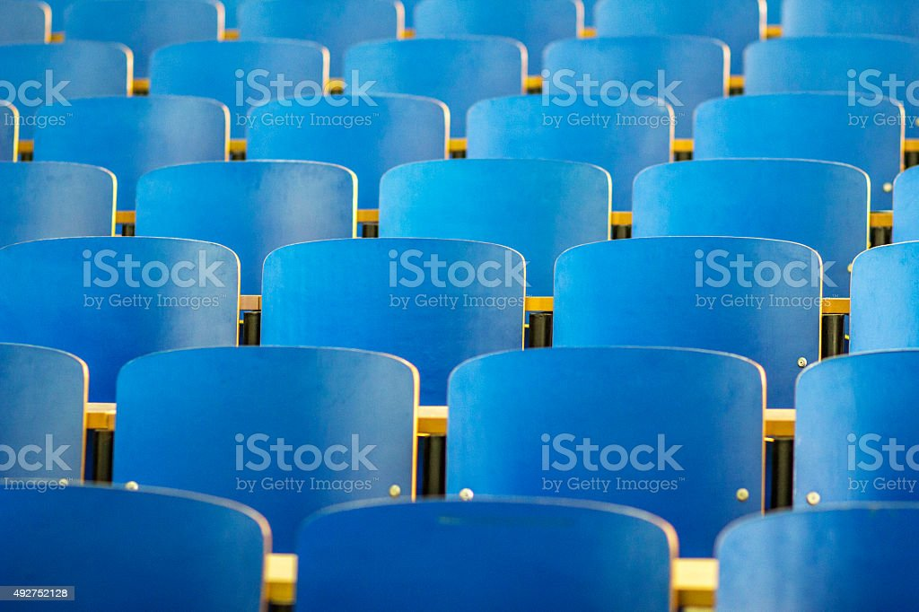 blue wooden chairs in auditorium hall stock photo