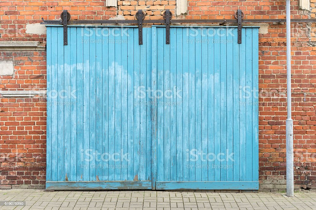 blue wooden gate stock photo