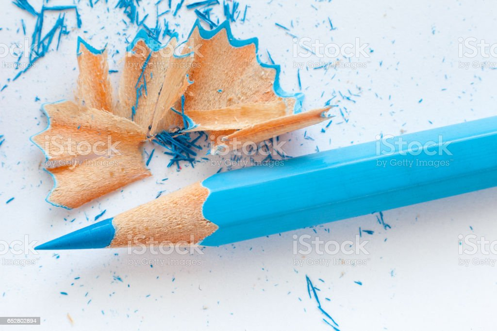 blue wooden pencil and pencil shavings stock photo