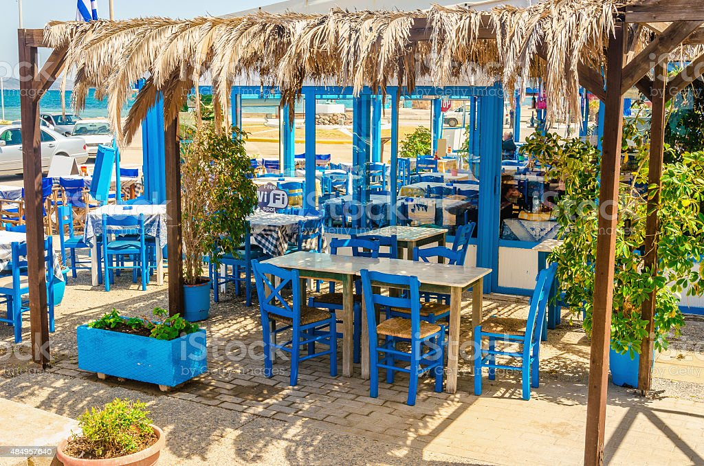 Blue wooden tables and chairs in Greek restaurant stock photo