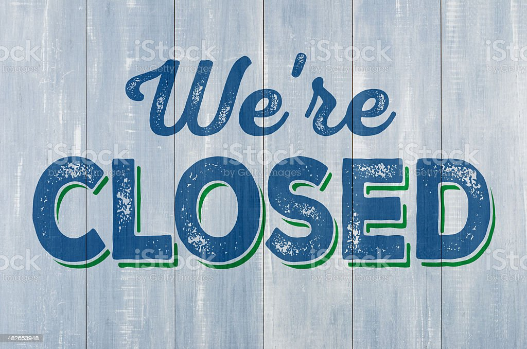 Blue wooden wall with the inscription We are closed stock photo