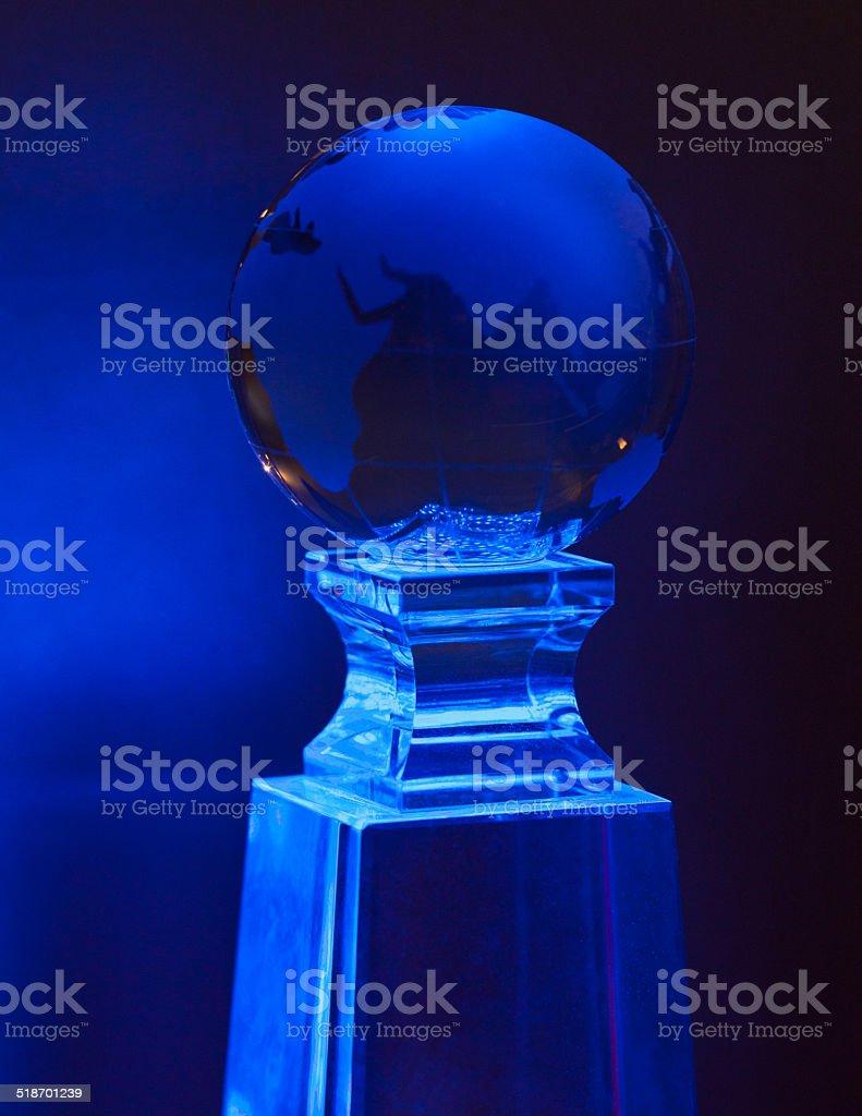 Blue world ball on a glass base royalty-free stock photo