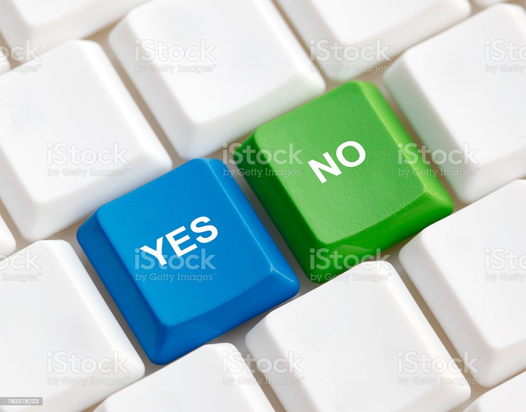 Blue yes key and green no key on a keyboard royalty-free stock photo