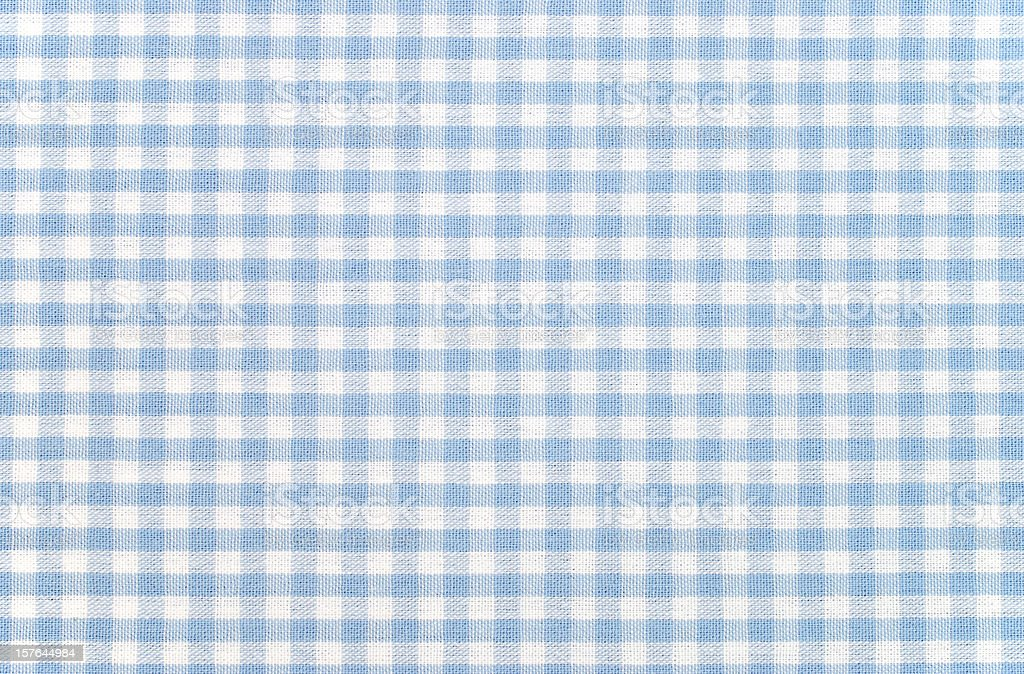 Blue-and-white checkered gingham fabric stock photo