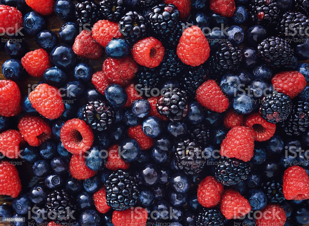 blueberies, raspberries and black berries shot top down stock photo