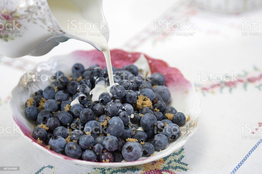 Blueberries and cream stock photo