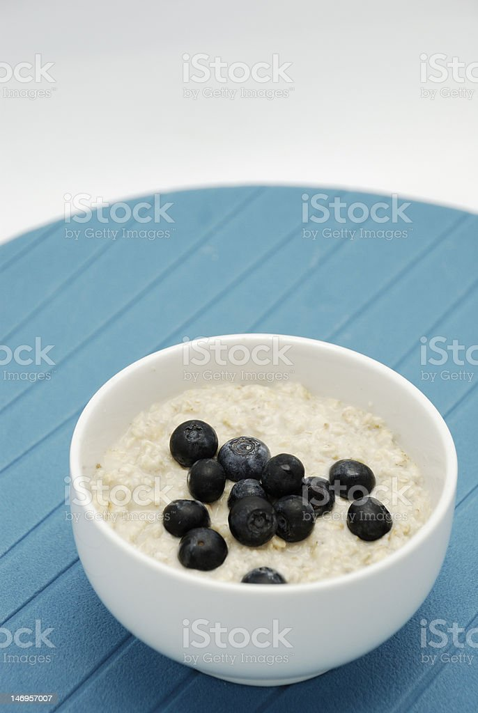 Blueberries and oatmeal in white bowl royalty-free stock photo