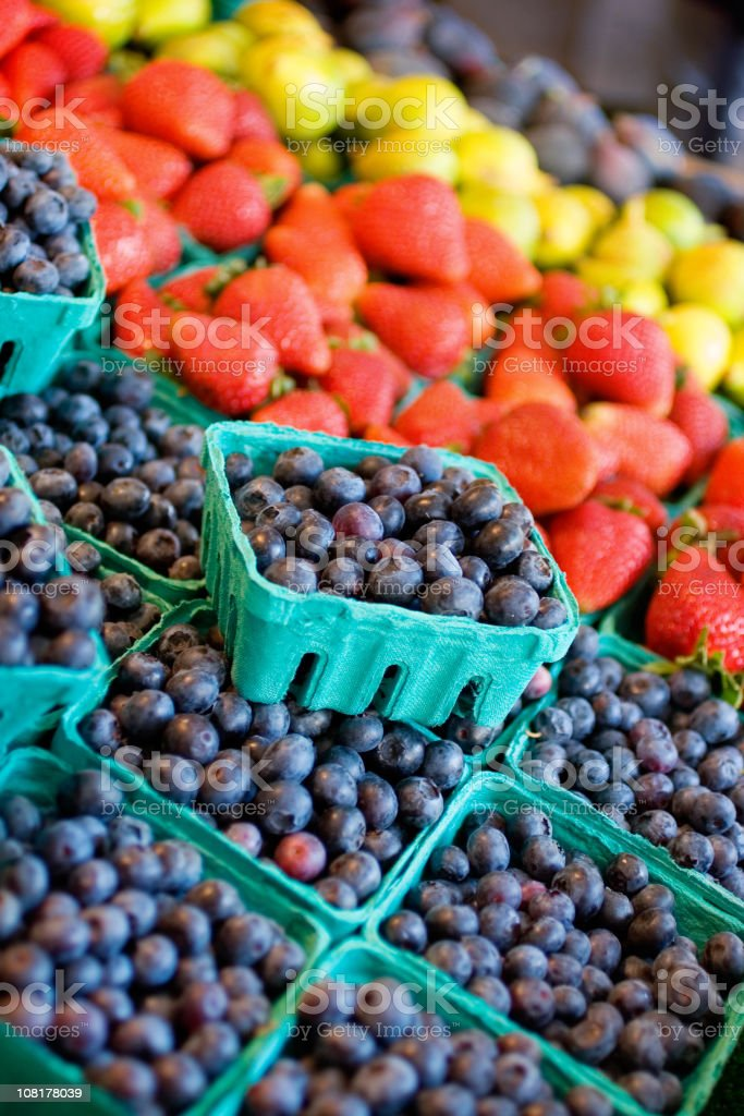 Blueberries and other fruits at farmer's market royalty-free stock photo