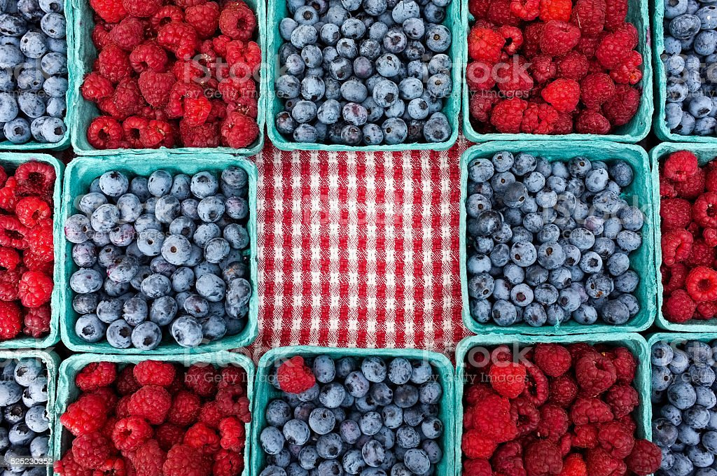 Blueberries and Raspberries for sale stock photo