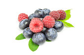 blueberries and raspberries on white background