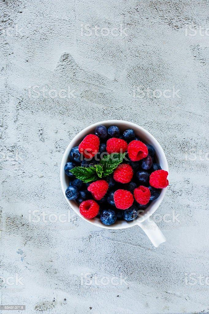 Blueberries and raspberries stock photo