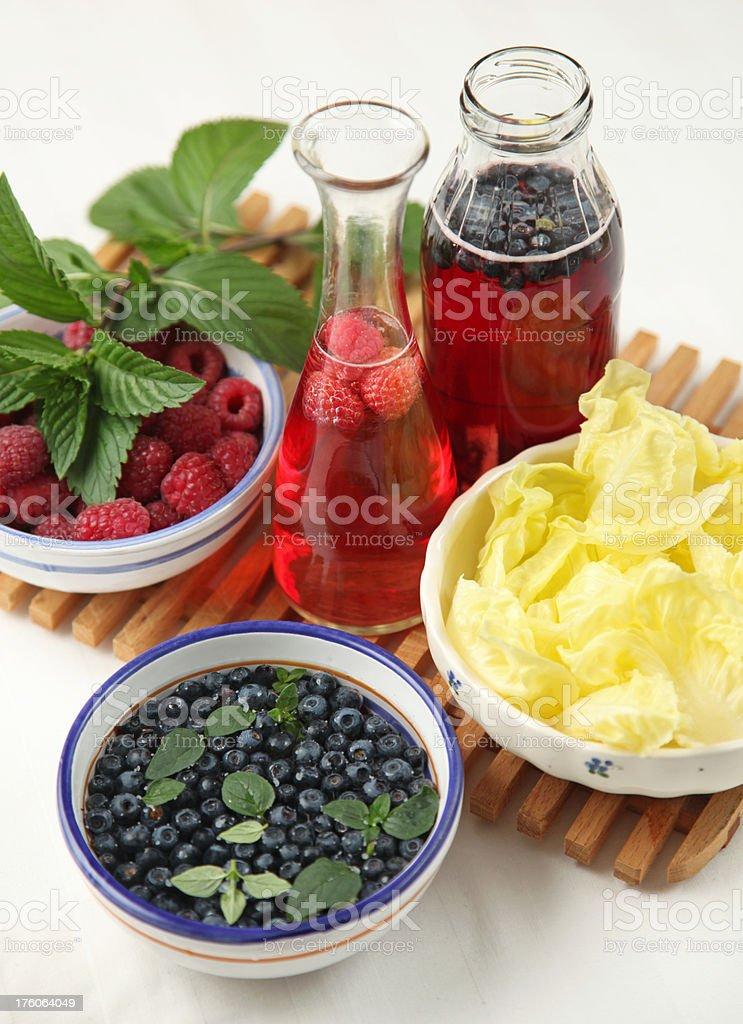 Blueberries and raspberries vinegar royalty-free stock photo