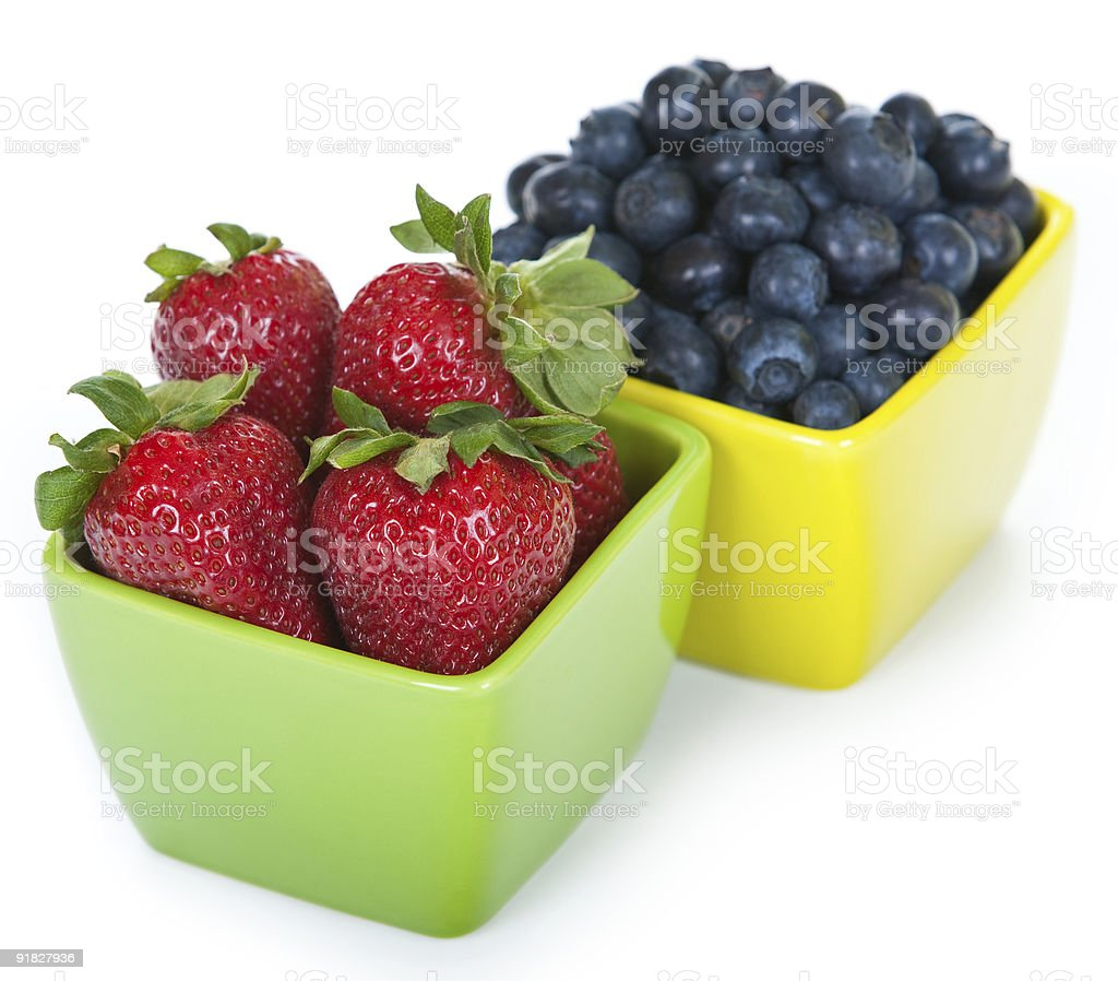 Blueberries and Strawberries in square bowls/cups royalty-free stock photo