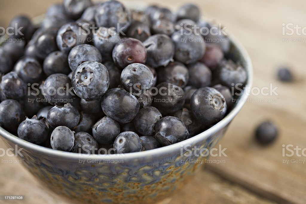 Blueberries In A Blue Bowl royalty-free stock photo