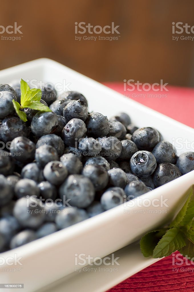 Blueberries in a White Square Bowl Vertical stock photo