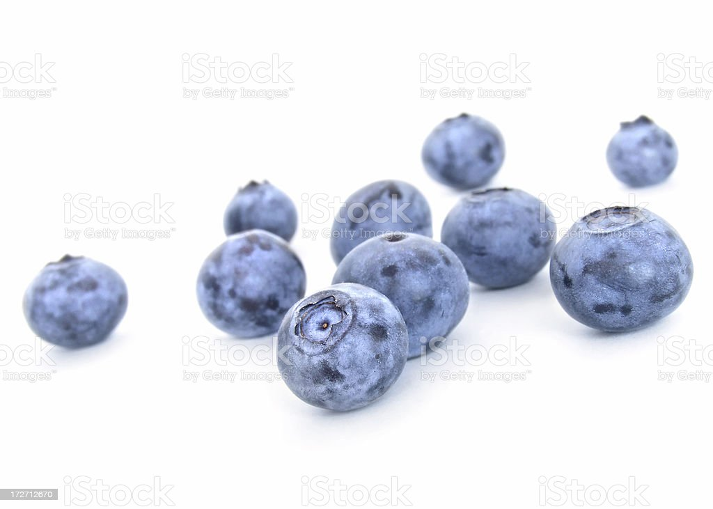 Blueberries on a white paper background royalty-free stock photo