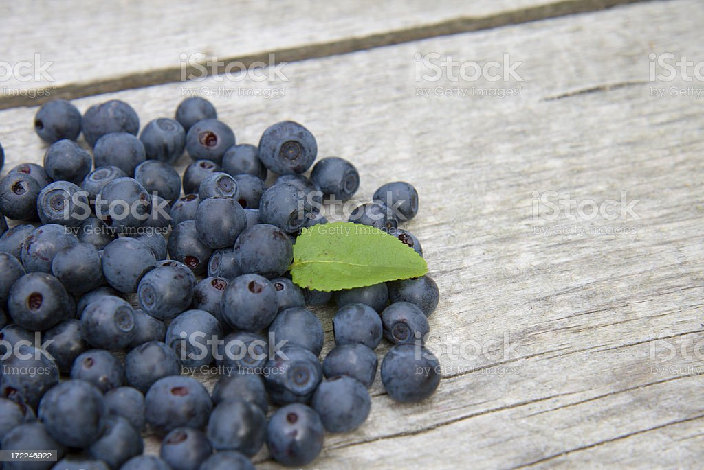 Blueberries on old wood stock photo