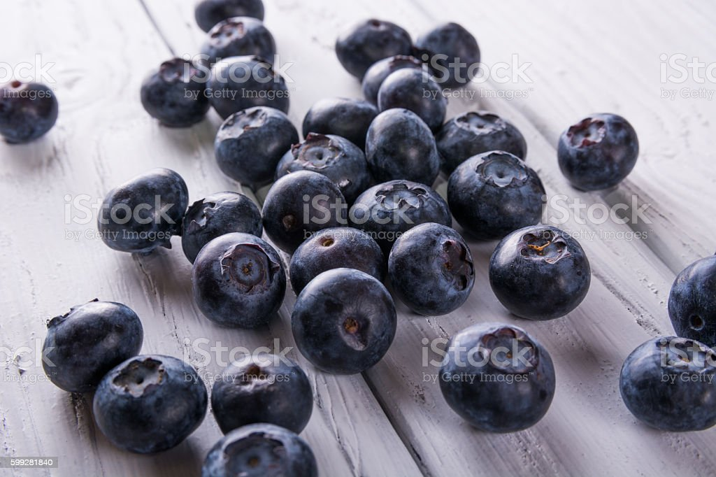Blueberries on white wooden table. Berries. stock photo