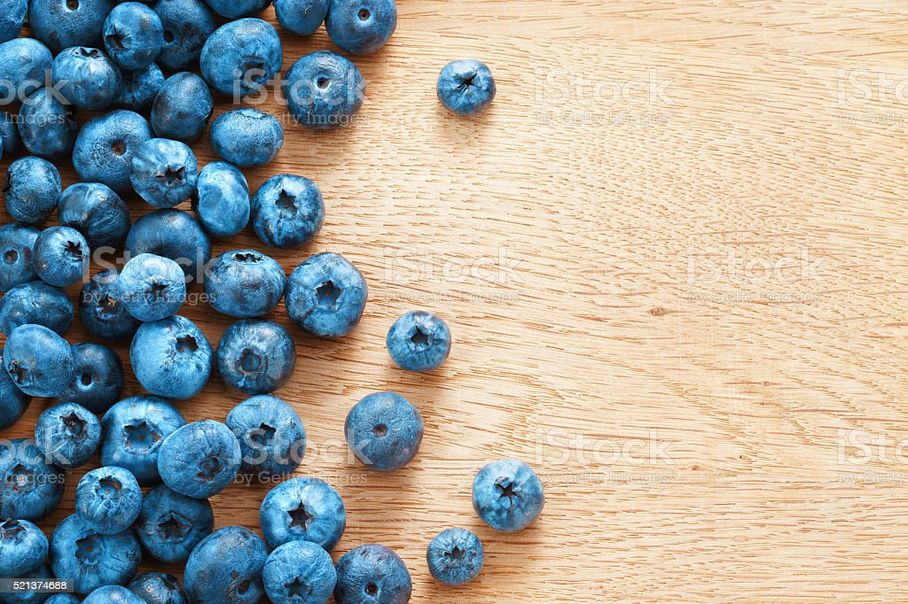 Blueberries on wooden background. stock photo