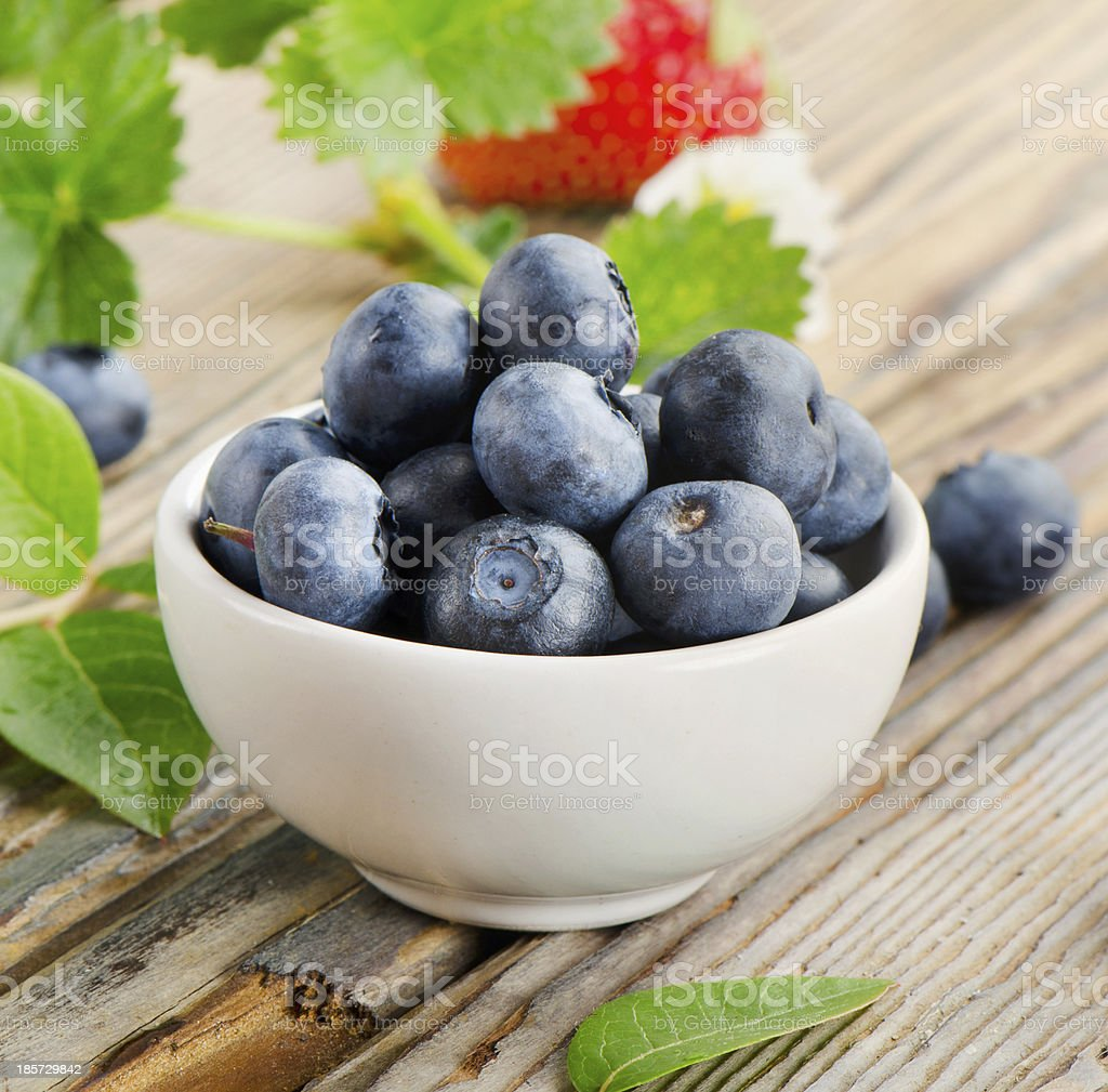Blueberries on wooden table royalty-free stock photo