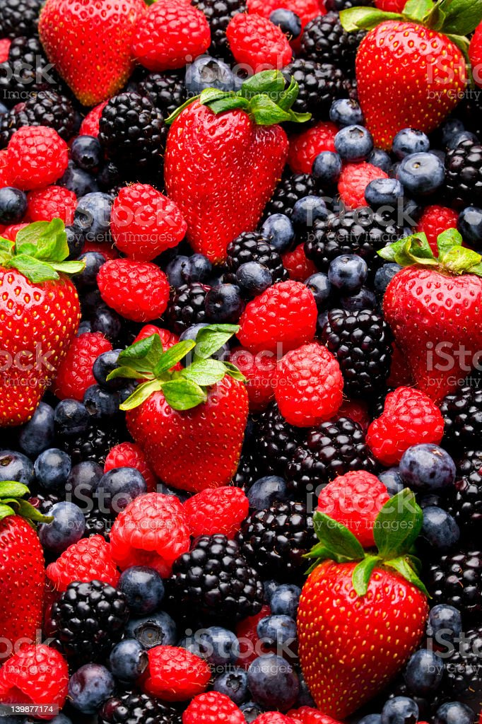 Blueberries, strawberries, raspberries, and blackberries royalty-free stock photo