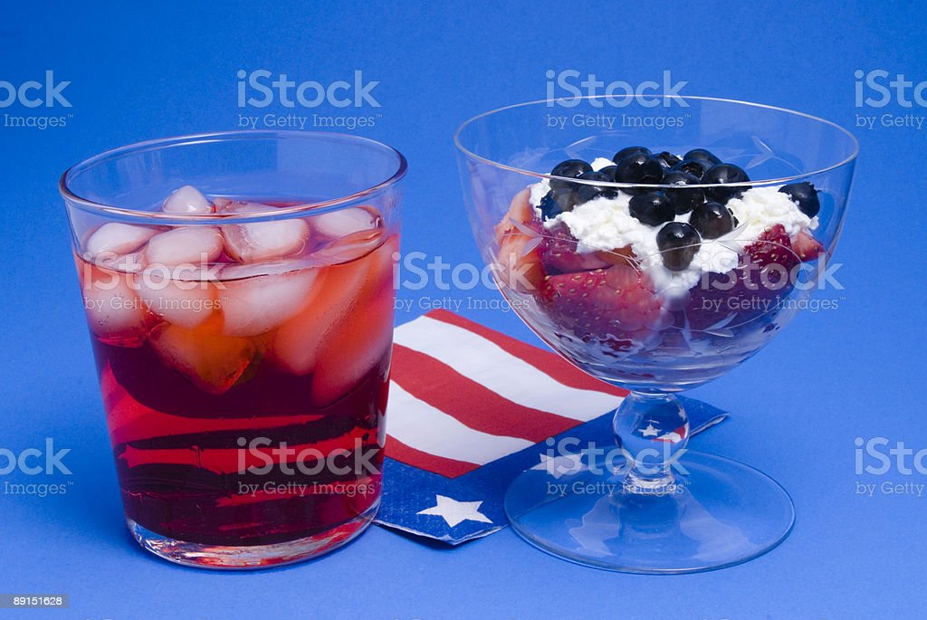 Blueberries, whipped cream, strawberries, red drink royalty-free stock photo