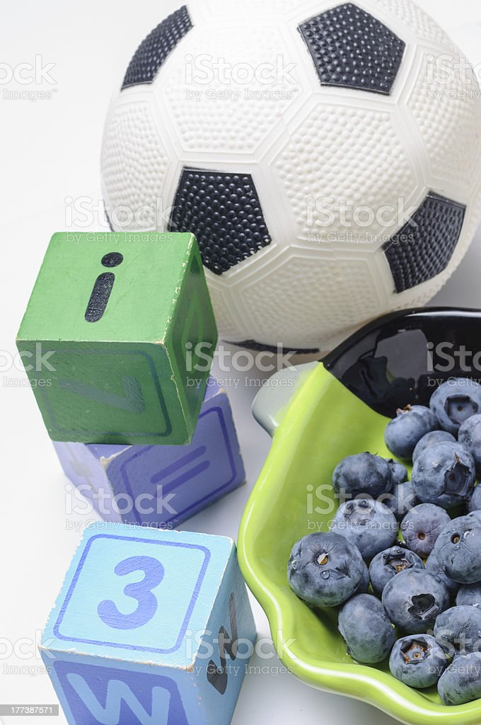 Blueberries with wooden blocks and soccer ball royalty-free stock photo
