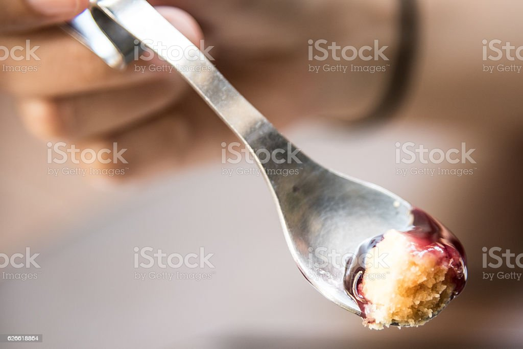 Blueberrry cheese cake on spoon close up macro shot stock photo