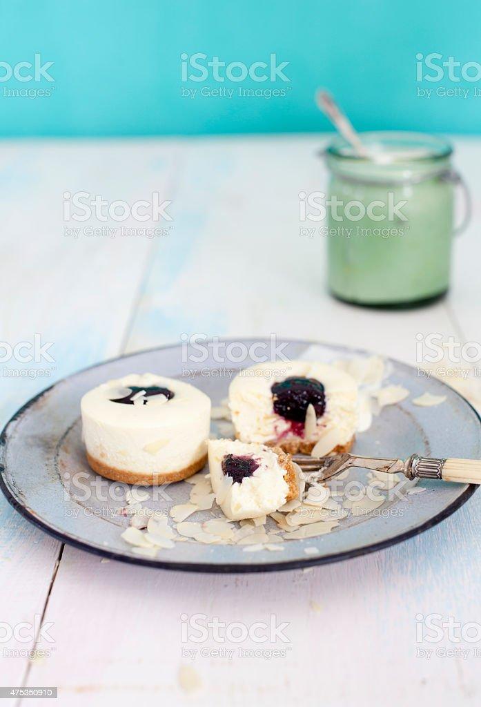 Blueberry and almond mini cheesecakes with vintage kitchenware stock photo