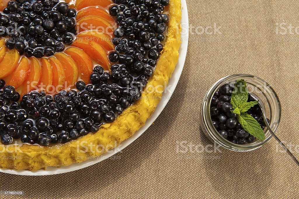 Blueberry and apricots Tart with fresh fruits stock photo