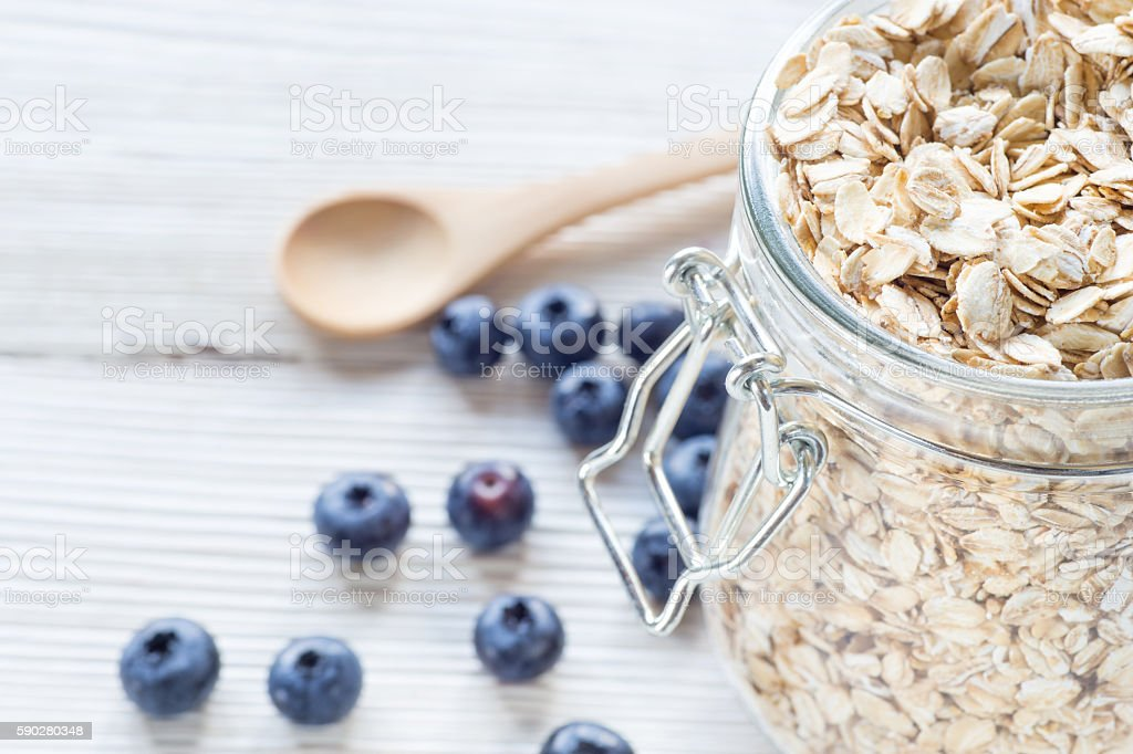 Blueberry and oat flake in mason jar stock photo