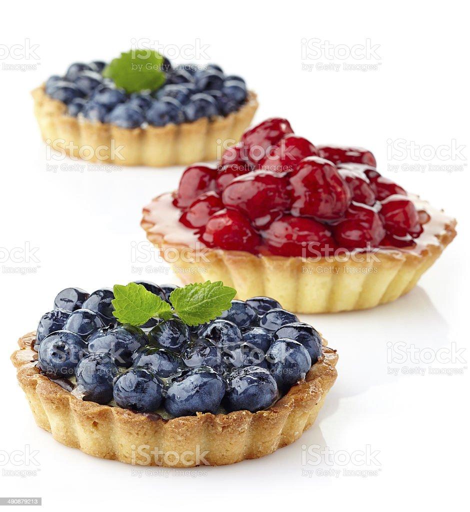 Blueberry and raspberry tarts stock photo